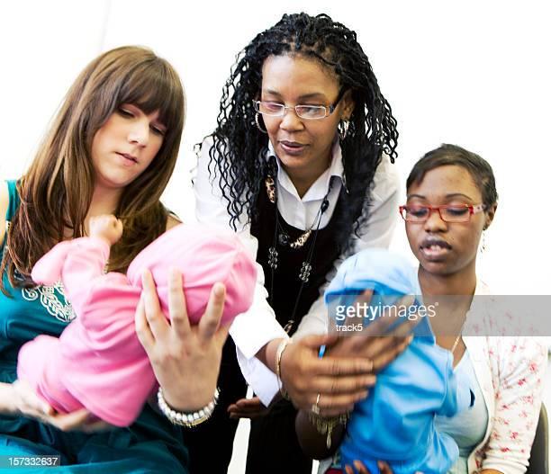 further education: nursery nurse students under supervision from their teacher