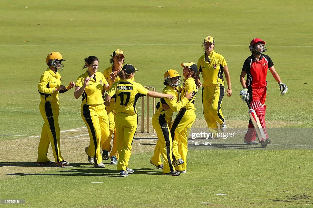 Fury players celebrate after dismissing Megan Schutt of the Scorpions and winning the WNCL match between the Western Australia Fury and the South Australia Scorpions at on December 8, 2012 in Perth, Australia.