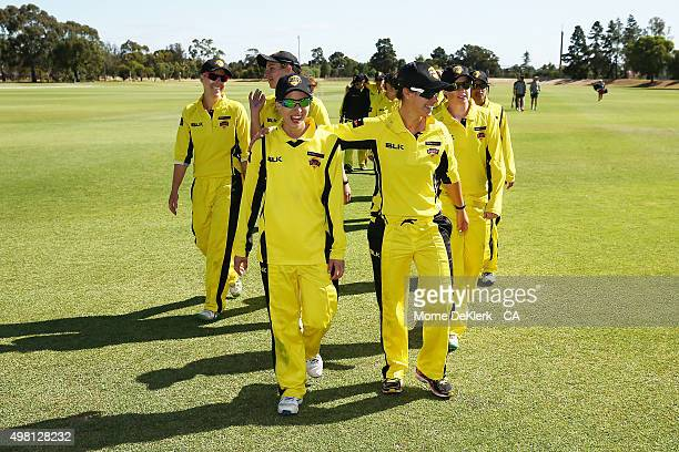 Fury players come from the field after winning the WNCL match between Tasmania and Western Australia at Park 25 on November 21 2015 in Adelaide...