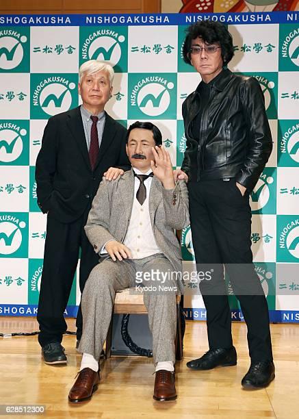 Fusanosuke Natsume a grandson of Japan's literary giant Soseki Natsume and Hiroshi Ishiguro a robotics researcher at Osaka University pose with a...