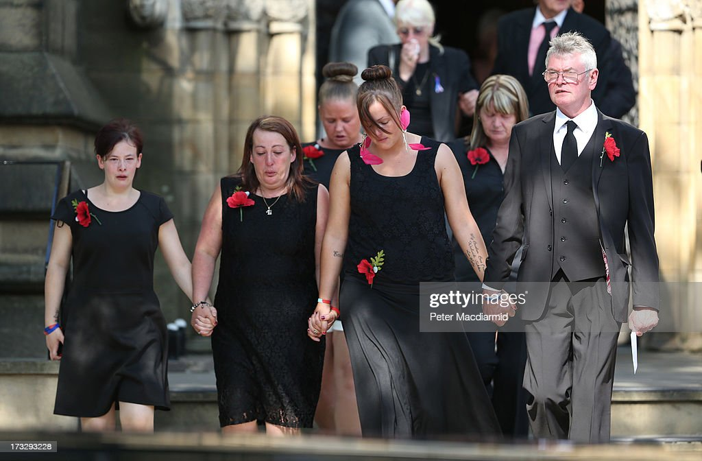 Fusilier Lee Rigby's family members including his mother Lyn Rigby and step father Ian Rigby leave Bury Parish Church after attending the start of an...