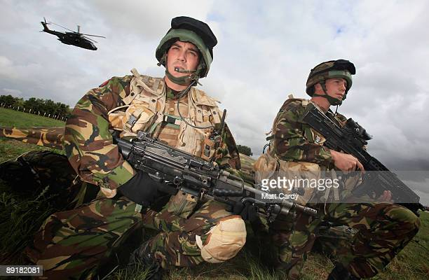 Fusiliers Jake Egan and Mark Goodier from the 1st Battalion The Royal Welsh take part in a predeployment training exercise on Salisbury Plain on July...