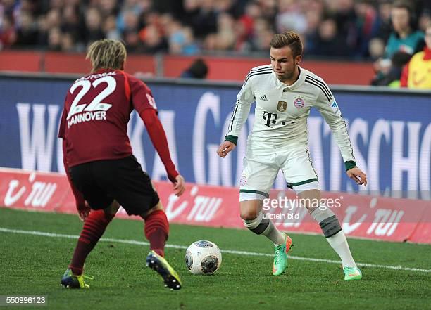 Fussball Saison 20132014 1 Bundesliga 22 Spieltag Hannover 96 FC Bayern Muenchen 04 Mario Goetze re gegen Frantisek Rajtoral