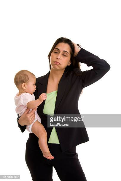 Fustrated mid adult businesswoman holding infant