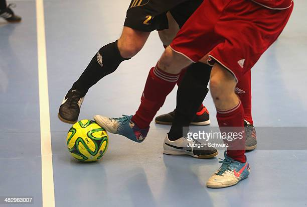 Futsal players try to control the ball during the DFB Futsal Cup Final between NAFI Stuttgart and Holzpfosten Schwerte on April 5 2014 in Iserlohn...