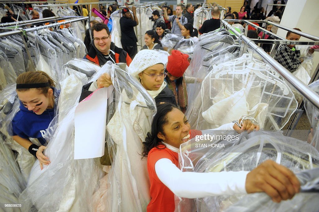 Future brides  family and friends race to grab wedding dresses off the  racks during Filenefuture brides family and friends race to grab wedding dresses off  the picture id96859925. Off The Rack Wedding Dresses Nyc. Home Design Ideas