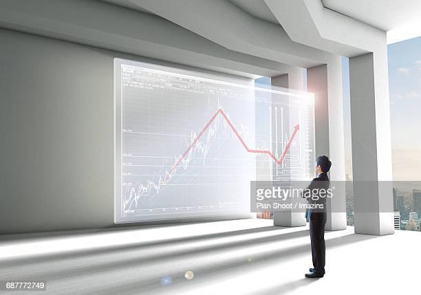 Future Businessman Looking at Financial Graph