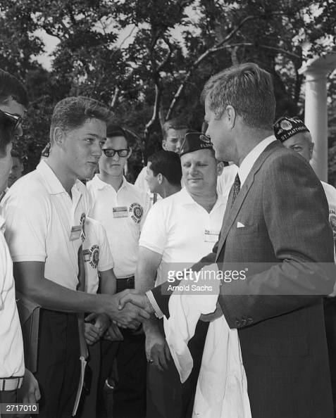 Future president Bill Clinton a teenage boy shakes the hand of President John F Kennedy as other American Legion Boys Nation delegates look on during...