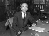 Future prime minister Sir Alec DouglasHome newlyappointed Foreign Secretary in Harold Macmillan's cabinet sitting in his office in Whitehall London...