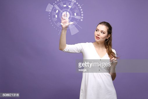Future technology. Woman working with futuristic interface : Stock Photo