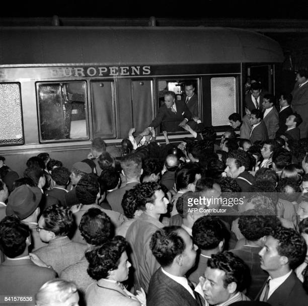 Future Tunisian President and NewDestour nationalist party leader Habib Bourguiba greets his supporters on May 31 1955 at Gare de Lyon in Paris in...