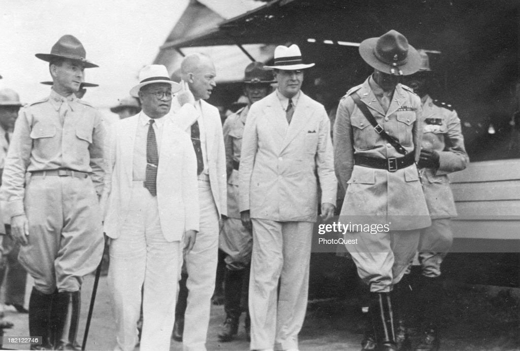 Future US President <a gi-track='captionPersonalityLinkClicked' href=/galleries/search?phrase=Dwight+Eisenhower&family=editorial&specificpeople=90742 ng-click='$event.stopPropagation()'>Dwight Eisenhower</a> (1890 - 1969) (center, no hat) and General Douglas MacArthur (1880 - 1964) (center, facing forward) walk with unidentified others, Philippines, mid 1930s.