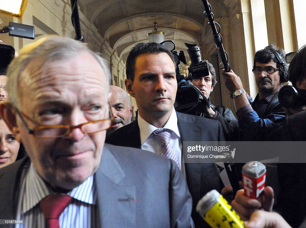 Futures trader <a gi-track='captionPersonalityLinkClicked' href=/galleries/search?phrase=Jerome+Kerviel&family=editorial&specificpeople=4840386 ng-click='$event.stopPropagation()'>Jerome Kerviel</a>, 33, (C) arrives with his lawyer <a gi-track='captionPersonalityLinkClicked' href=/galleries/search?phrase=Olivier+Metzner&family=editorial&specificpeople=852837 ng-click='$event.stopPropagation()'>Olivier Metzner</a> at the Palais de Justice court on June 8, 2010 in Paris, France. Kerviel faces charges of breach of trust, computer hacking and falsification of records leading to SocGen (Societe Generale) bank losing EURO 4.9 billion (GBP £4 billion); exposed in January 2008.
