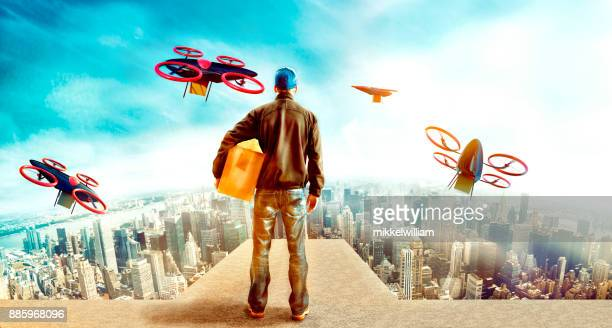 Futuristic city with delivery person sending off drones with packages from skyscraper