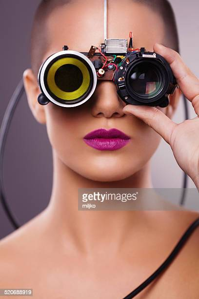 Futuristic cyborg girl wearing optical electronic glasses