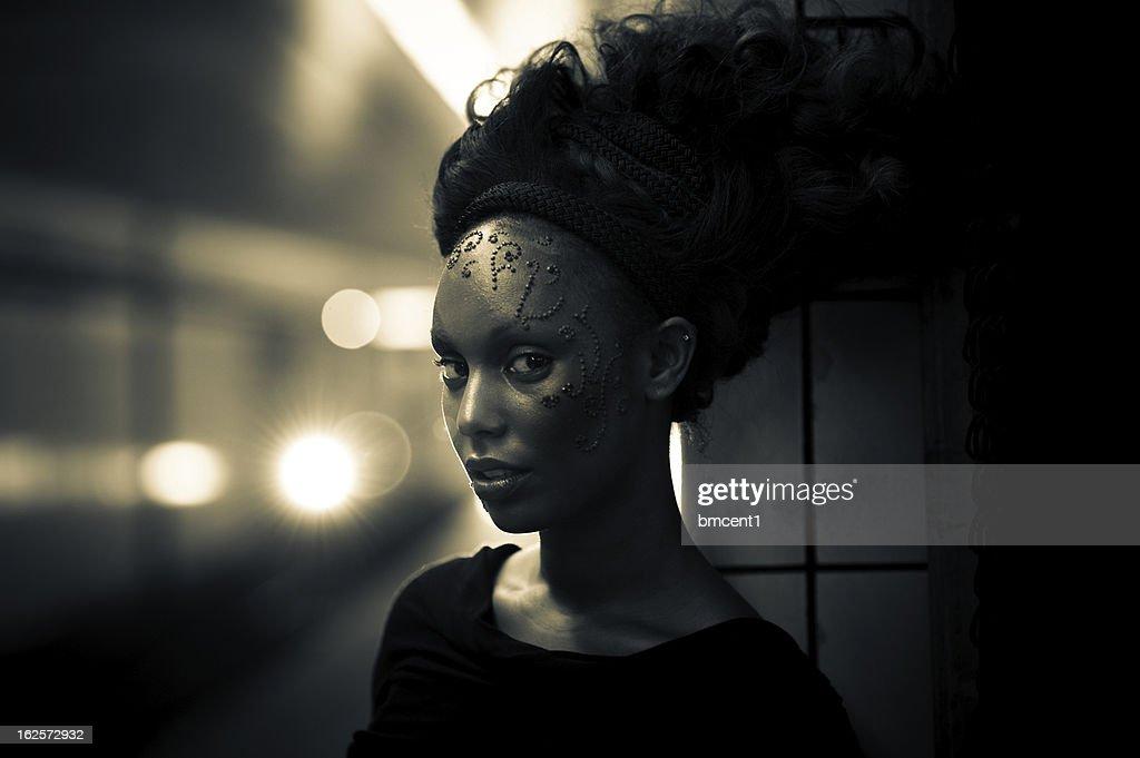 Futuristic Decorated Woman on Subway Platform : Stock Photo