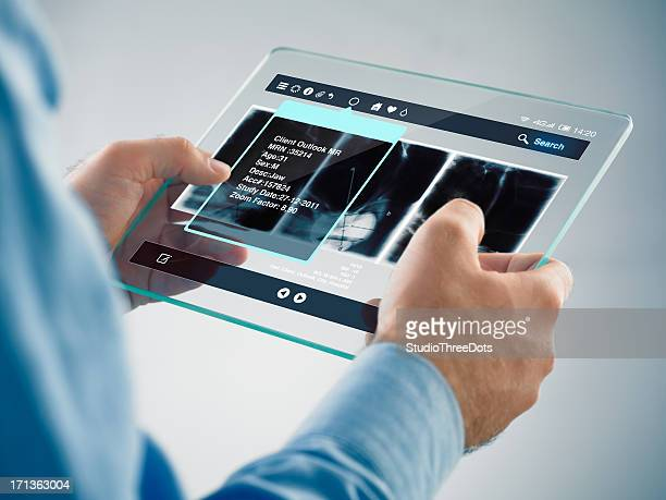 Futuristic digital tablet in the hands