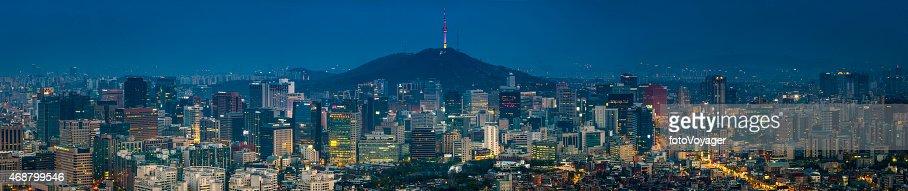 Futuristic downtown cityscape illuminated skyscrapers neon highrise panorama Seoul Korea