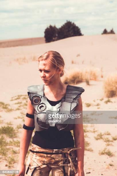 Futuristic Female Warrior Walking Through The Desert