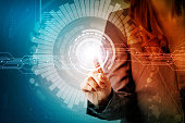 futuristic graphical user interface concept. businesswoman pointing virtual screen. Internet of Things. Heads up display. technological abstract.