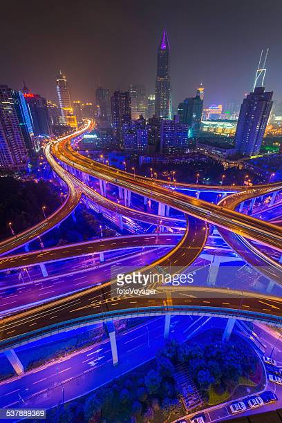 Futuristic highway neon skyscraper cityscape illuminated at night Shanghai China