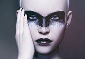 portrait of a fashion model and futuristic make up art