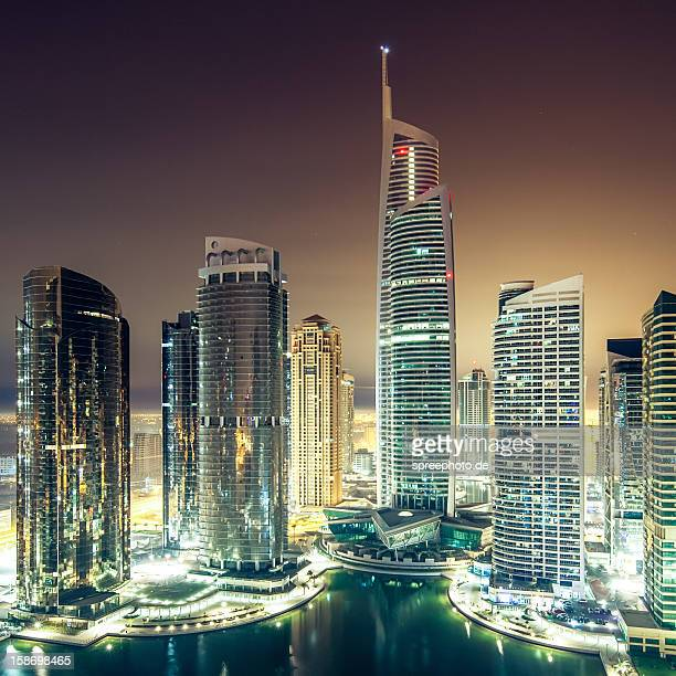 Futuristic marina skyline at night