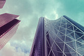 A low-angled view of corporate skyscrapers with a Cloud sky with a copy space