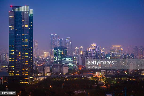 Futuristic neon night city urban highrise illuminated Seoul South Korea