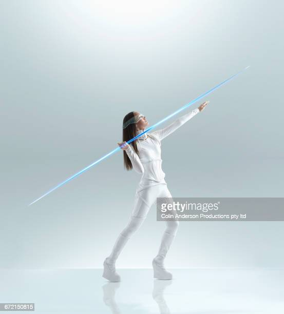 Futuristic Pacific Islander woman aiming glowing hi-tech javelin