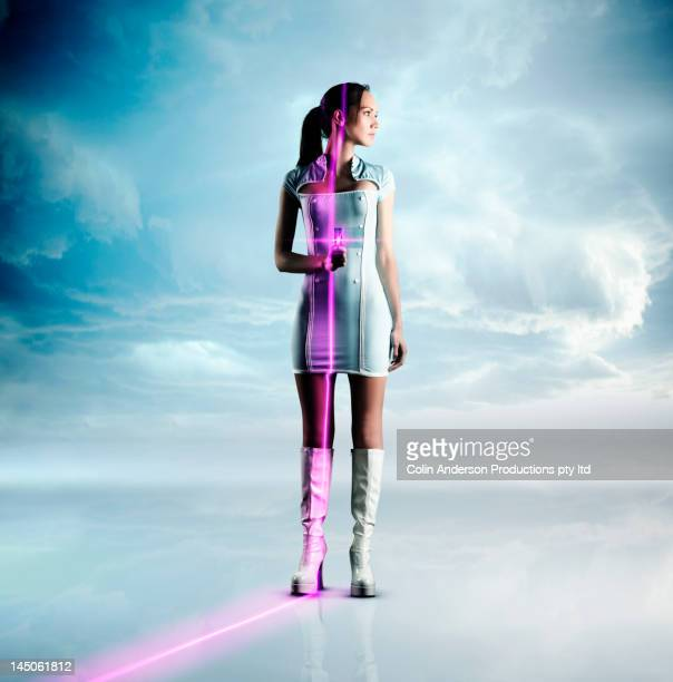 Futuristic Pacific Islander woman holding glowing screen