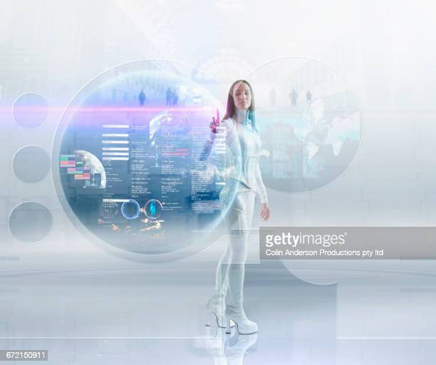 Futuristic Pacific Islander woman touching floating hologram
