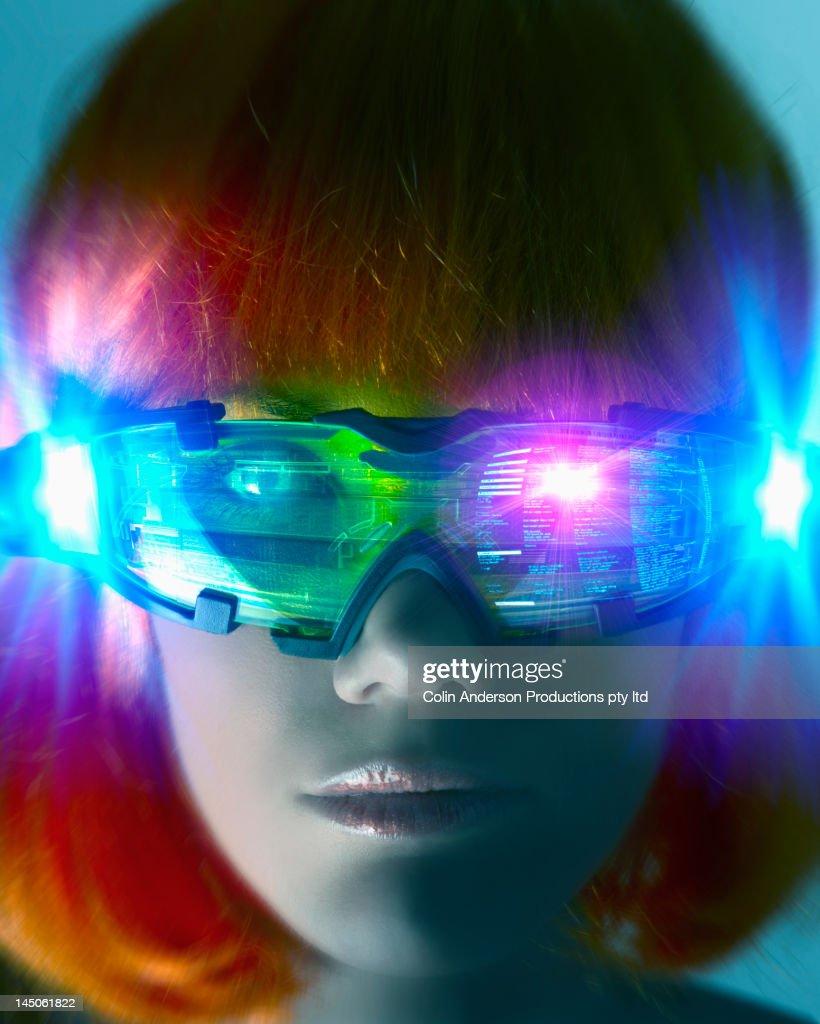 Futuristic Pacific Islander woman wearing digital eyeglasses : Stock Photo