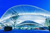 Futuristic Railway Station Building Illuminated at Night