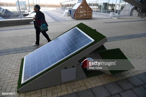 A futuristic solar dog house designed by Gensler on display for the Sustainable BARKitecture Dog House Competition at Denver International Airport...