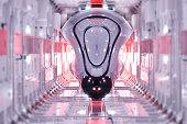 Modern, futuristic train moving in an illuminated tunnel.