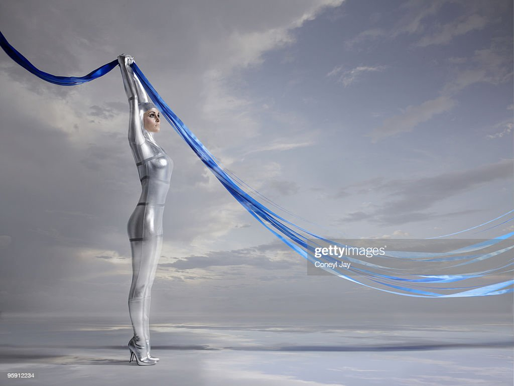 Futuristic woman holding blue glowing lines : Stock Photo