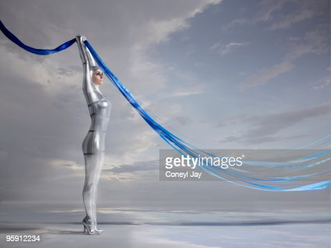 Futuristic woman holding blue glowing lines : ストックフォト
