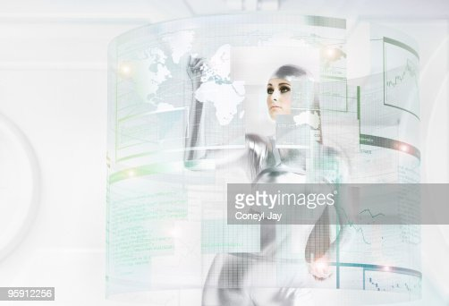 Futuristic woman manipulating holographic data : Stock Photo