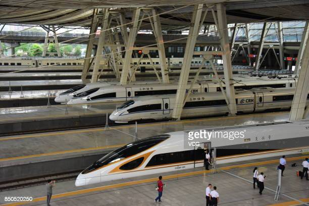 A 'Fuxing' bullet train prepares to set off from Beijing South Railway Station on September 21 2017 in Beijing China China's 'Fuxing' bullet trains...
