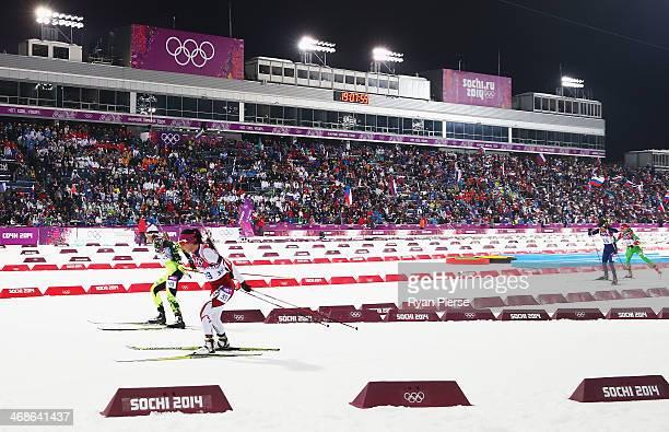 Fuyuko Suzuki of Japan competes during the Biathlon Women's 10km Pursuit during the Sochi 2014 Winter Olympics at Laura Crosscountry Ski Biathlon...