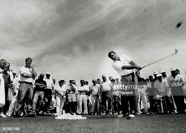 Fuzzy view Fuzzy Zoeller shows off his classic swing to spectators at Lionhead golf club in Brampton site of a Skins Game today and tomorrow Four...