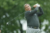 Fuzzy Zoeller hits a shot on June 6 2002 during the first round of the Senior PGA Championship at Firestone CC in Akron