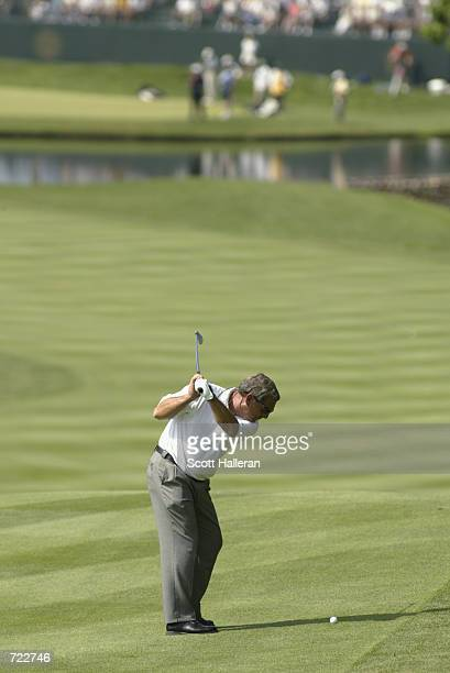 Fuzzy Zoeller hits a shot on June 9 2002 during the final round of the Senior PGA Championship at Firestone CC in Akron