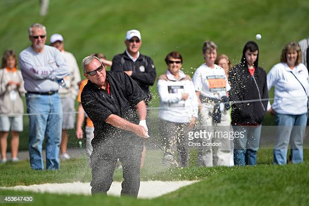 Fuzzy Zoeller hits from a bunker on the first hole during the first round of the Champions Tour Dick's Sporting Goods Open at EnJoie Golf Course on...