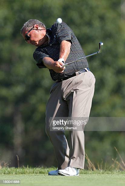 Fuzzy Zoeller hits his tee shot on the ninth hole during the first round of the 2012 Senior United States Open at Indianwood Golf and Country Club on...