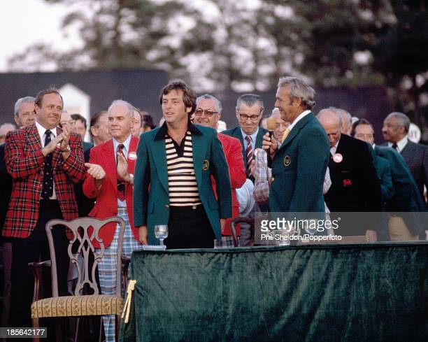 Fuzzy Zoeller of the United States with Arnold Palmer and tournament officials during the presentation ceremony after winning the US Masters Golf...