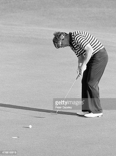 Fuzzy Zoeller of the USA holes a crucial putt n the final green to make a 3way play off with Ed Sneed and Tom Watson Zoeller went on to win the green...