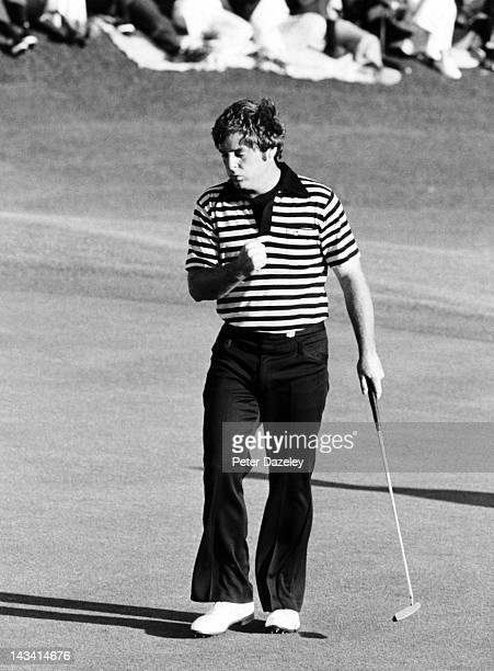 Fuzzy Zoeller of the USA holes a vital putt on the 72nd hole in the final round during the 1978 Masters Tournament at Augusta National Golf Club on...