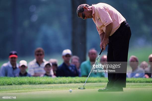 Fuzzy Zoeller puts during the the US Senior Open at Firestone Country Club in Akron Ohio on June 5 2002